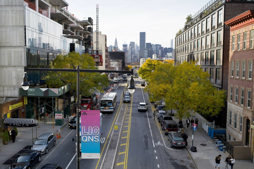 FILE - In this Nov. 7, 2018 file photo, traffic moves along 44th Drive in Long Island City in the Queens borough of New York, near the proposed site f...