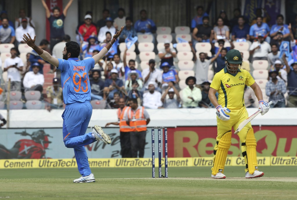 Indian bowler Jasprit Bumrah celebrates the wicket of Australia's Aaron Finch during the first one-day international cricket match between India and A...
