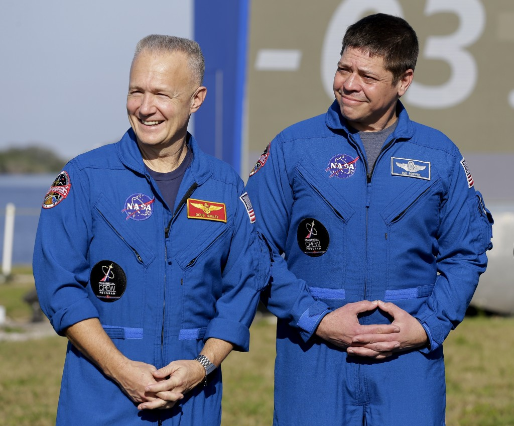 NASA astronauts Doug Hurley, left, and Bob Behnken attend a news conference before the Falcon 9 SpaceX Crew Demo-1 rocket launch at the Kennedy Space