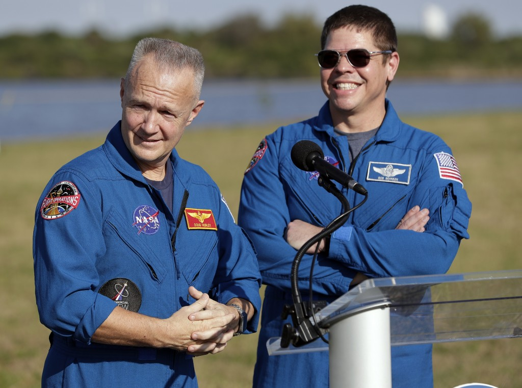 NASA astronauts Doug Hurley, left, and Bob Behnken answer questions during a news conference before the Falcon 9 SpaceX Crew Demo-1 rocket launch at t...