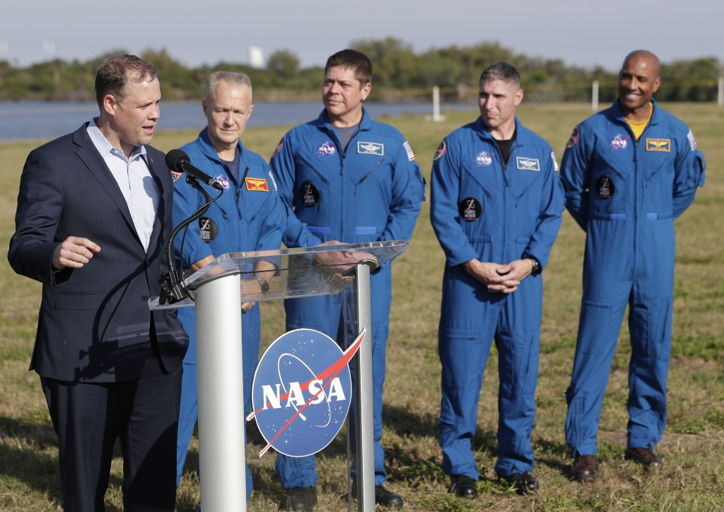 NASA Administrator Jim Bridenstine, left, speaks at a news conference with astronauts, from second left, Doug Hurley, Bob Behnken, Mike Hopkins and Vi...