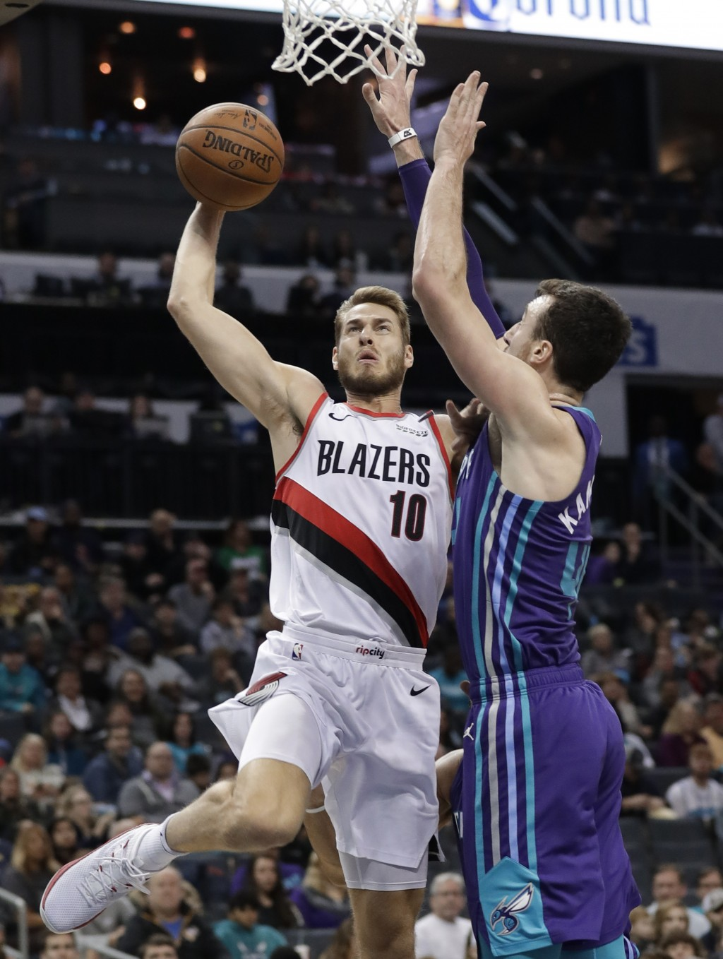 Portland Trail Blazers' Jake Layman (10) shoots against Charlotte Hornets' Frank Kaminsky (44) during the first half of an NBA basketball game in Char