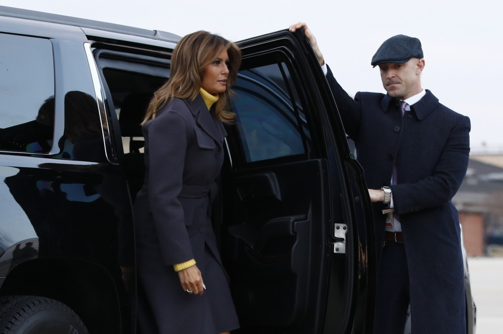 First lady Melania Trump steps out of a vehicle before boarding an aircraft Monday, March 4, 2019, at Andrews Air Force Base, Md., en route to Tulsa,