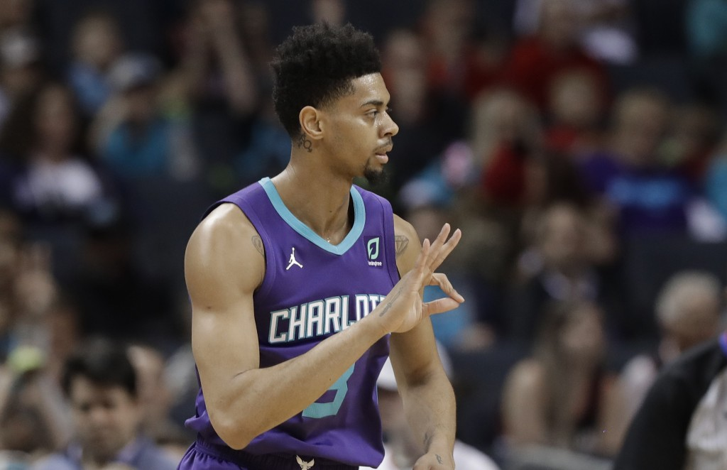Charlotte Hornets' Jeremy Lamb (3) gestures after making a three-point basket against the Portland Trail Blazers during the first half of an NBA baske