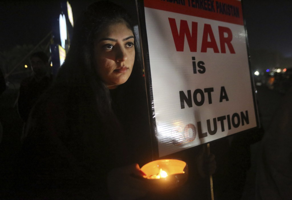 A member of the civil society group, Citizens of Lahore, participates in a candlelit vigil against war, in Lahore, Pakistan, Sunday, March 3, 2019. Re...