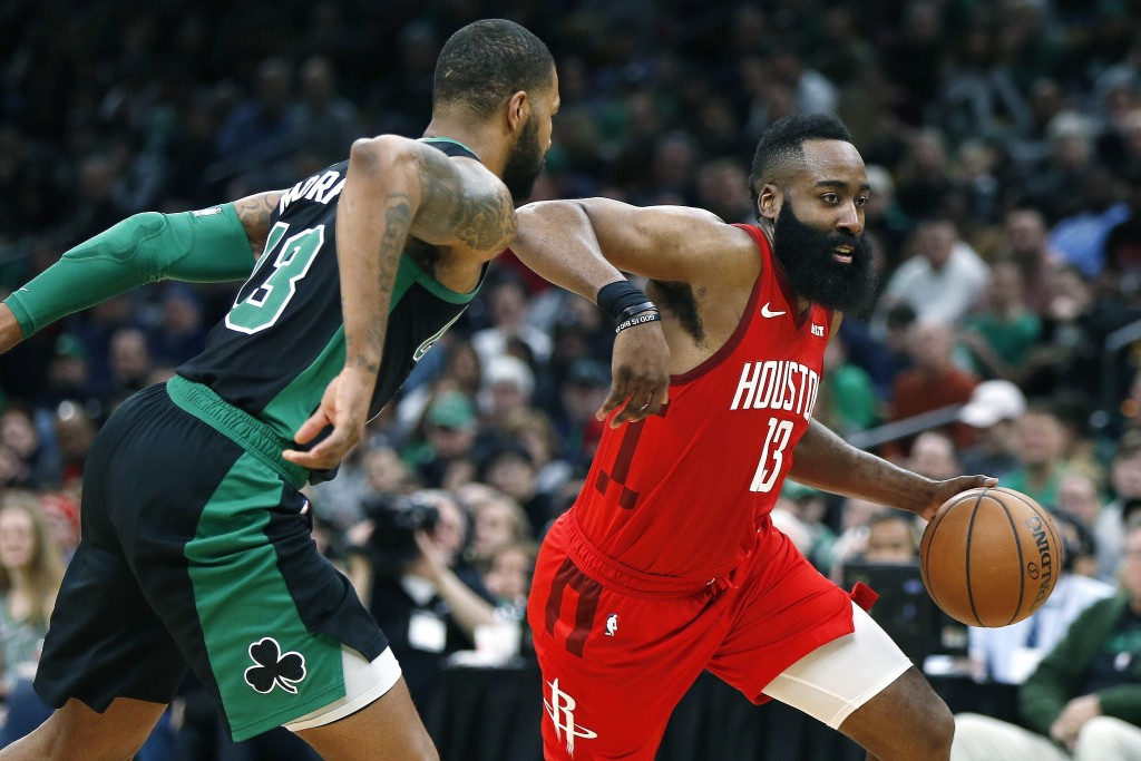 Houston Rockets' James Harden, right, drives past Boston Celtics' Marcus Morris during the second half of an NBA basketball game in Boston, Sunday, Ma