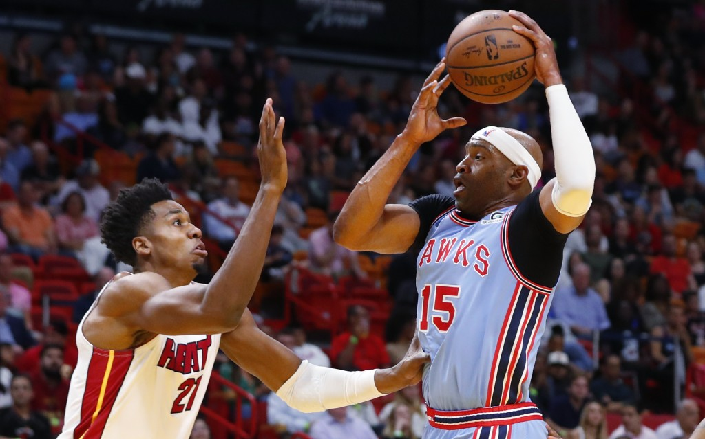 Atlanta Hawks forward Vince Carter (15) goes up to shoot against Miami Heat center Hassan Whiteside (21) during the first half of an NBA basketball ga
