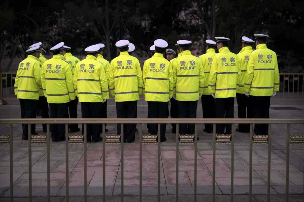 Chinese police gather outside the Great Hall of the People, ahead of the opening session of China's National People's Congress (NPC) in Beijing, Tuesd...