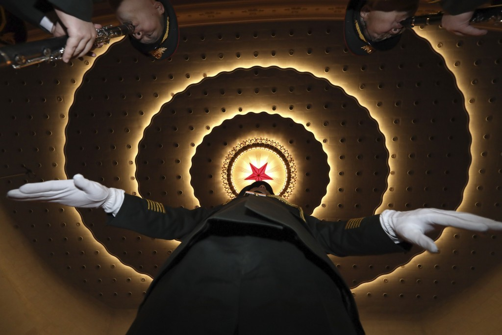 A Chinese military band conductor rehearses before the opening session of the annual National People's Congress in Beijing's Great Hall of the People,...