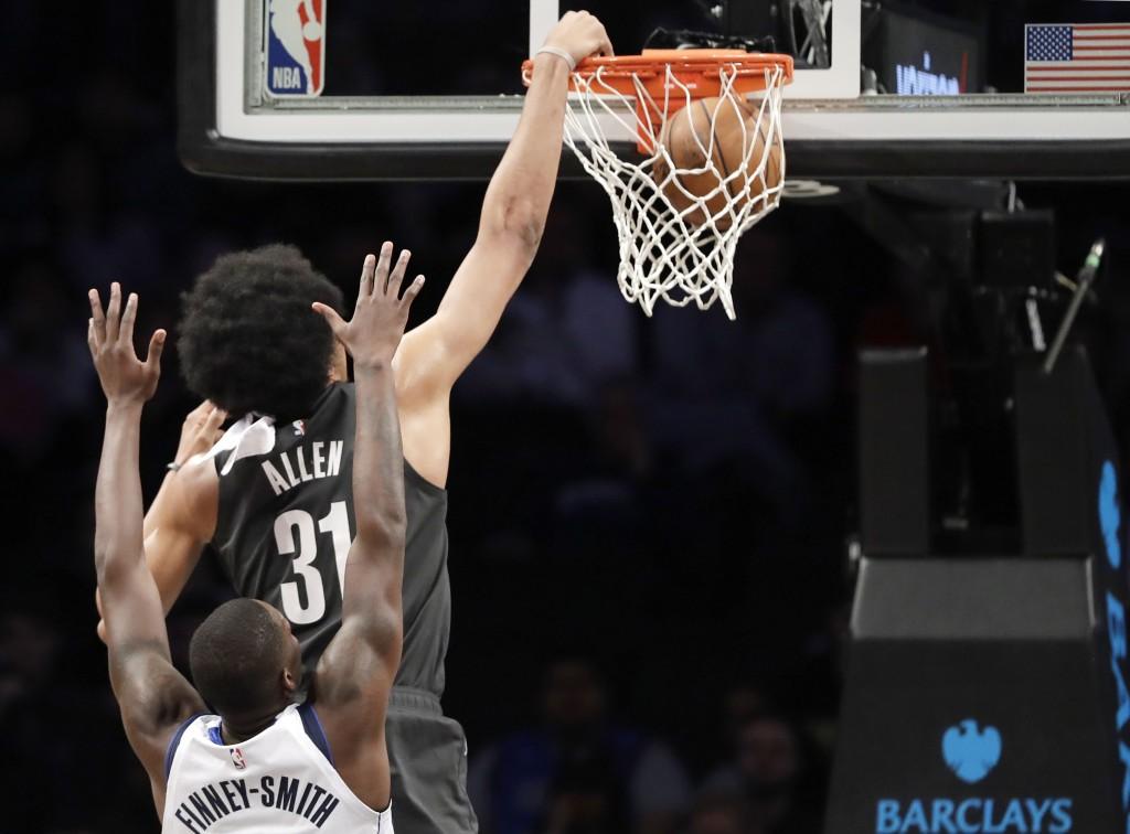 Brooklyn Nets center Jarrett Allen (31 dunks in front of Dallas Mavericks forward Dorian Finney-Smith, bottom, during the first half of an NBA basketb