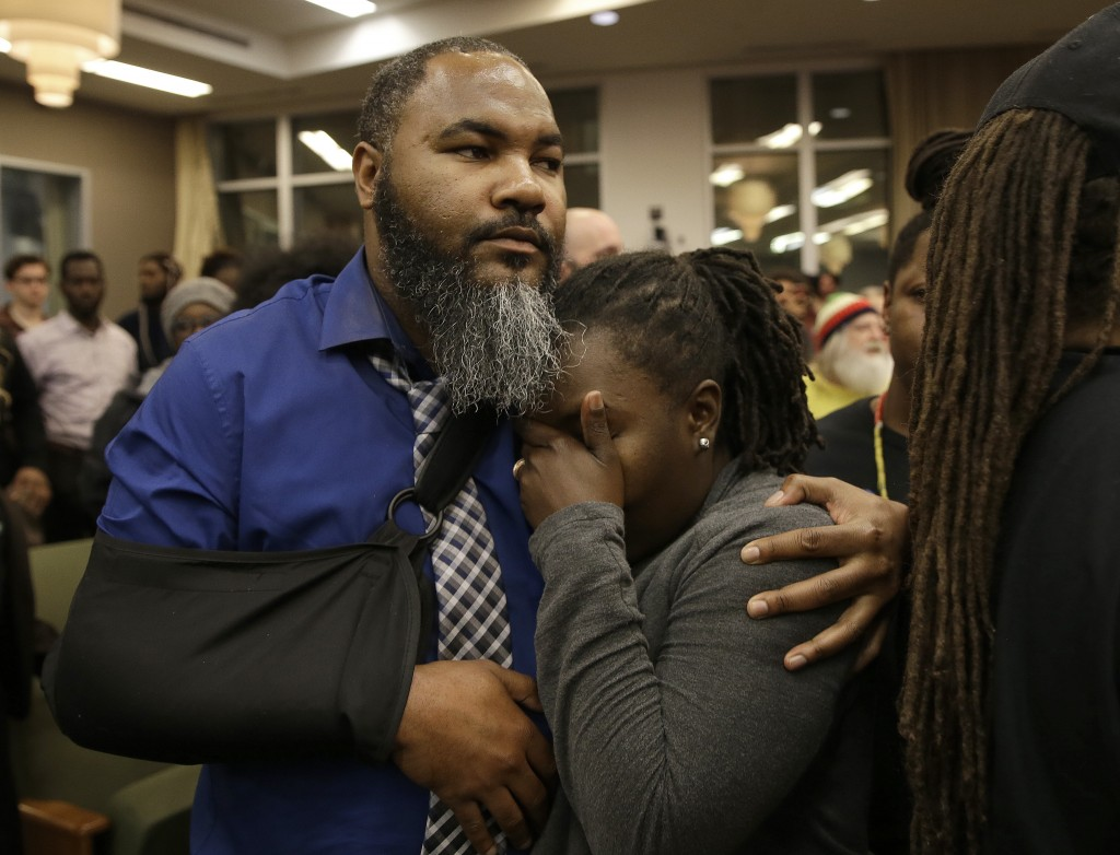 Ryan McClinton comforts Dr. Flojaune Cofer as a disruption breaks out Tuesday, March 5, 2019, in Sacramento, Calif. Community members expressed anger ...
