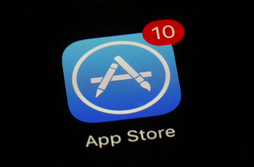 FILE - This March 19, 2018, file photo shows Apple's App Store app in Baltimore. As its iPhone sales slip, Apple has been touting its growing digital-...