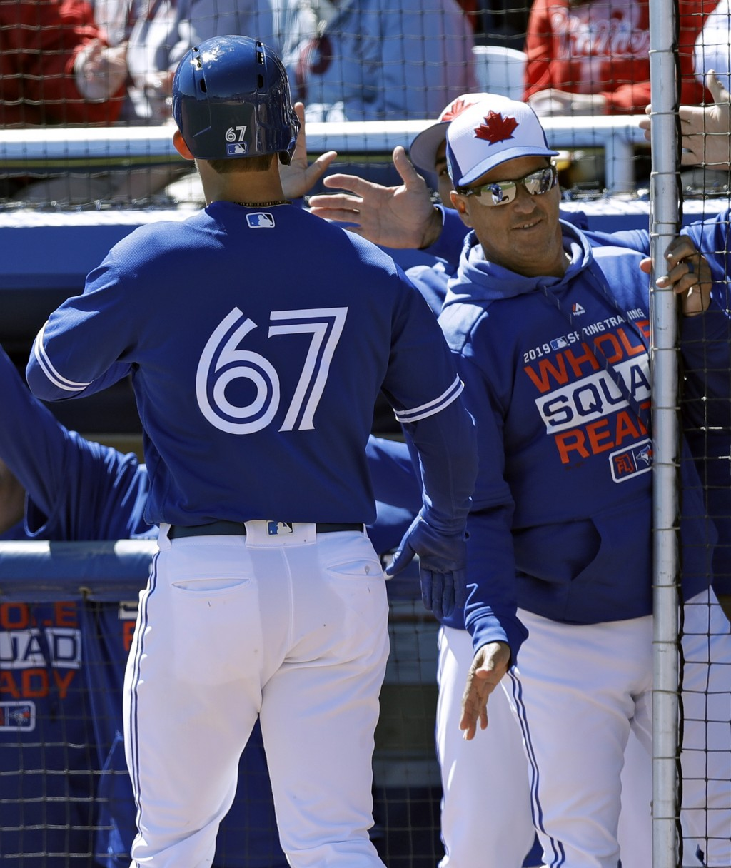 41c61d5a192 Toronto Blue Jays  Cavan Biggio (67) shakes hands with manager Charlie  Montoya after