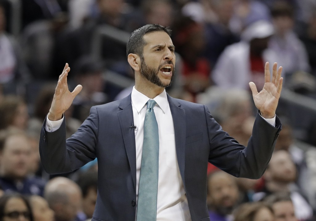 Charlotte Hornets coach James Borrego reacts to a call during the first half of the team's NBA basketball game against the Miami Heat in Charlotte, N.