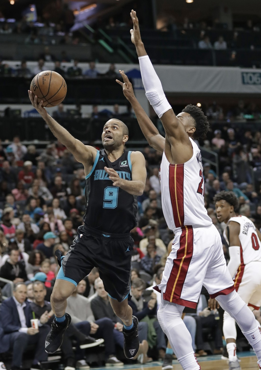 Charlotte Hornets' Tony Parker (9) drives past Miami Heat's Hassan Whiteside during the first half of an NBA basketball game in Charlotte, N.C., Wedne