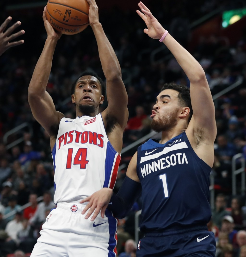 Detroit Pistons guard Ish Smith (14) looks to pass as Minnesota Timberwolves guard Tyus Jones (1) defends during the first half of an NBA basketball g