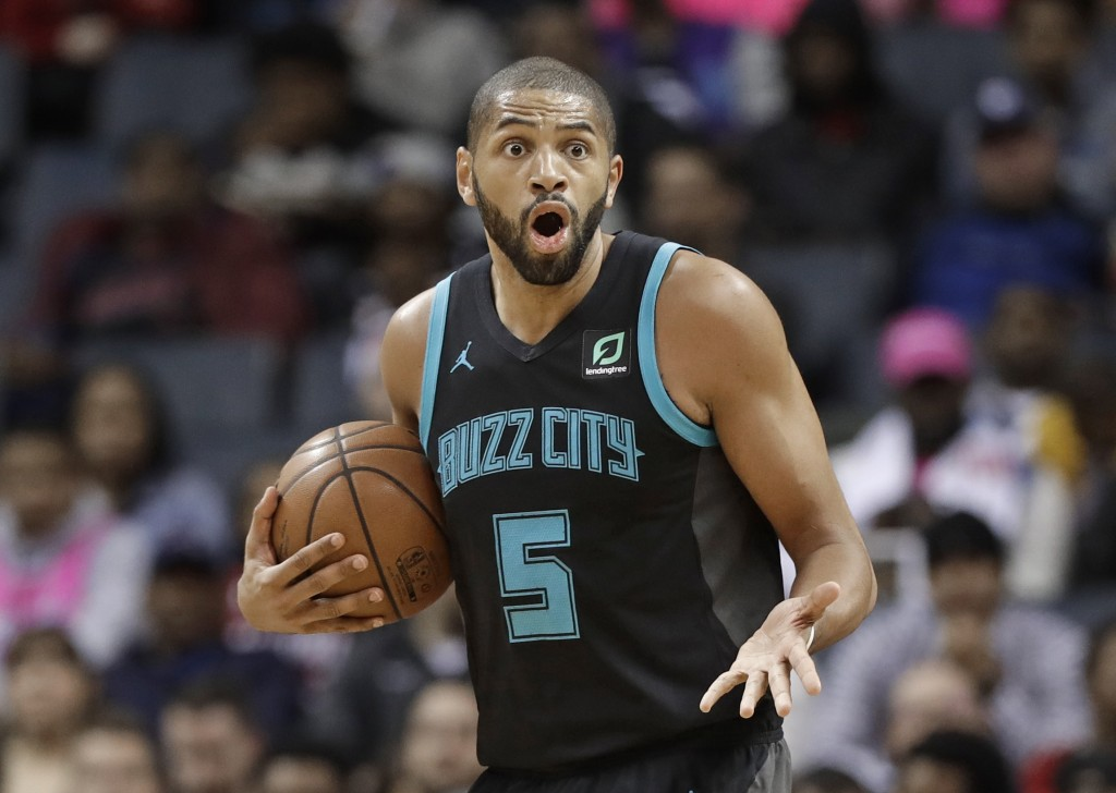 Charlotte Hornets' Nicolas Batum reacts after being called for a foul against the Miami Heat during the first half of an NBA basketball game in Charlo