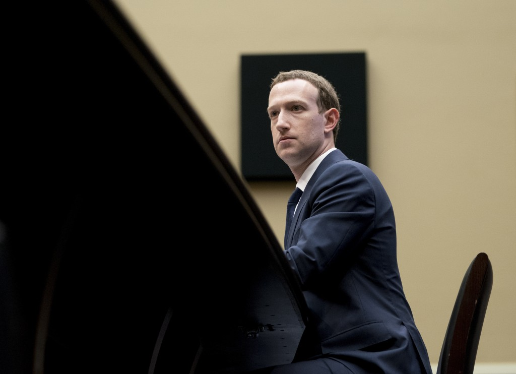 In this April 11, 2018, photo, Facebook CEO Mark Zuckerberg listens to a question as he testifies before a House Energy and Commerce hearing on Capito