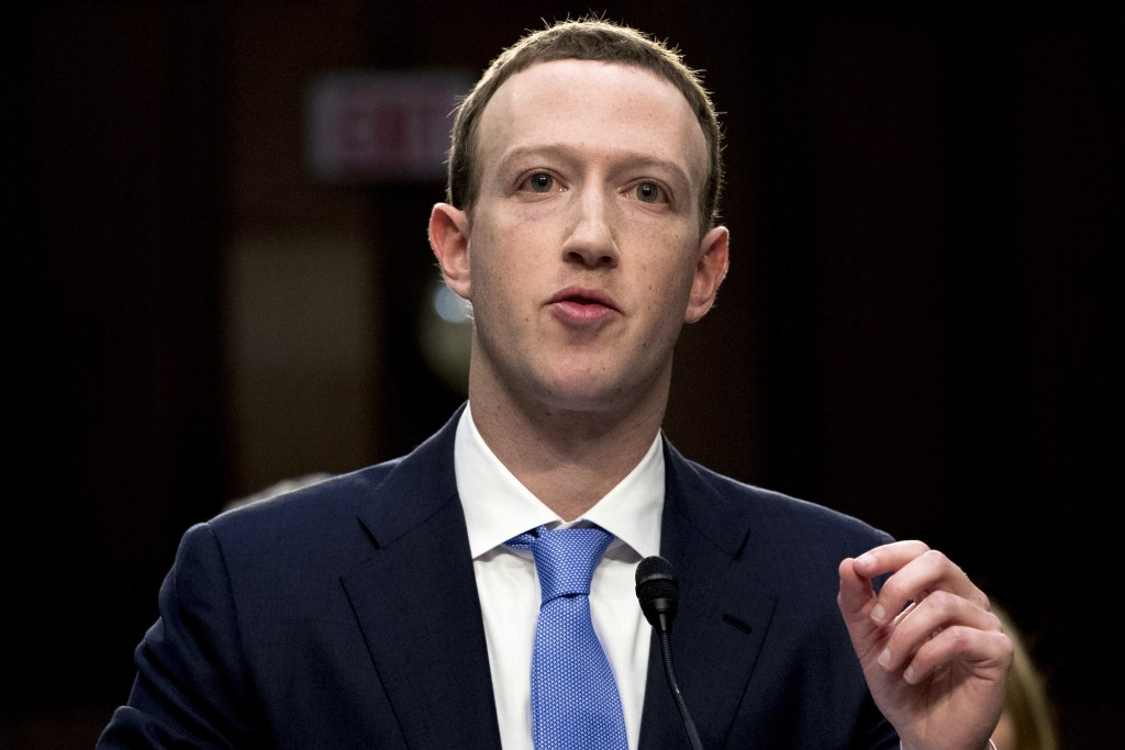 FILE - In this April 10, 2018, file photo, Facebook CEO Mark Zuckerberg testifies before a joint hearing of the Commerce and Judiciary Committees on C...