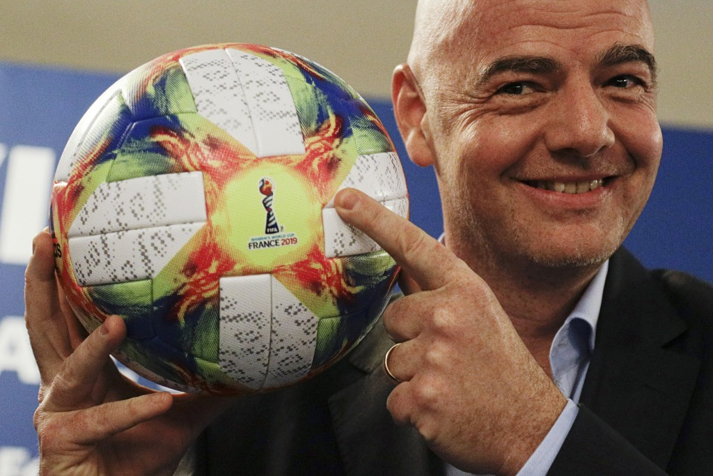FILE - In this Feb. 27, 2019, file photo, FIFA President Gianni Infantino holds the official ball of the upcoming Women's Soccer World Championship as