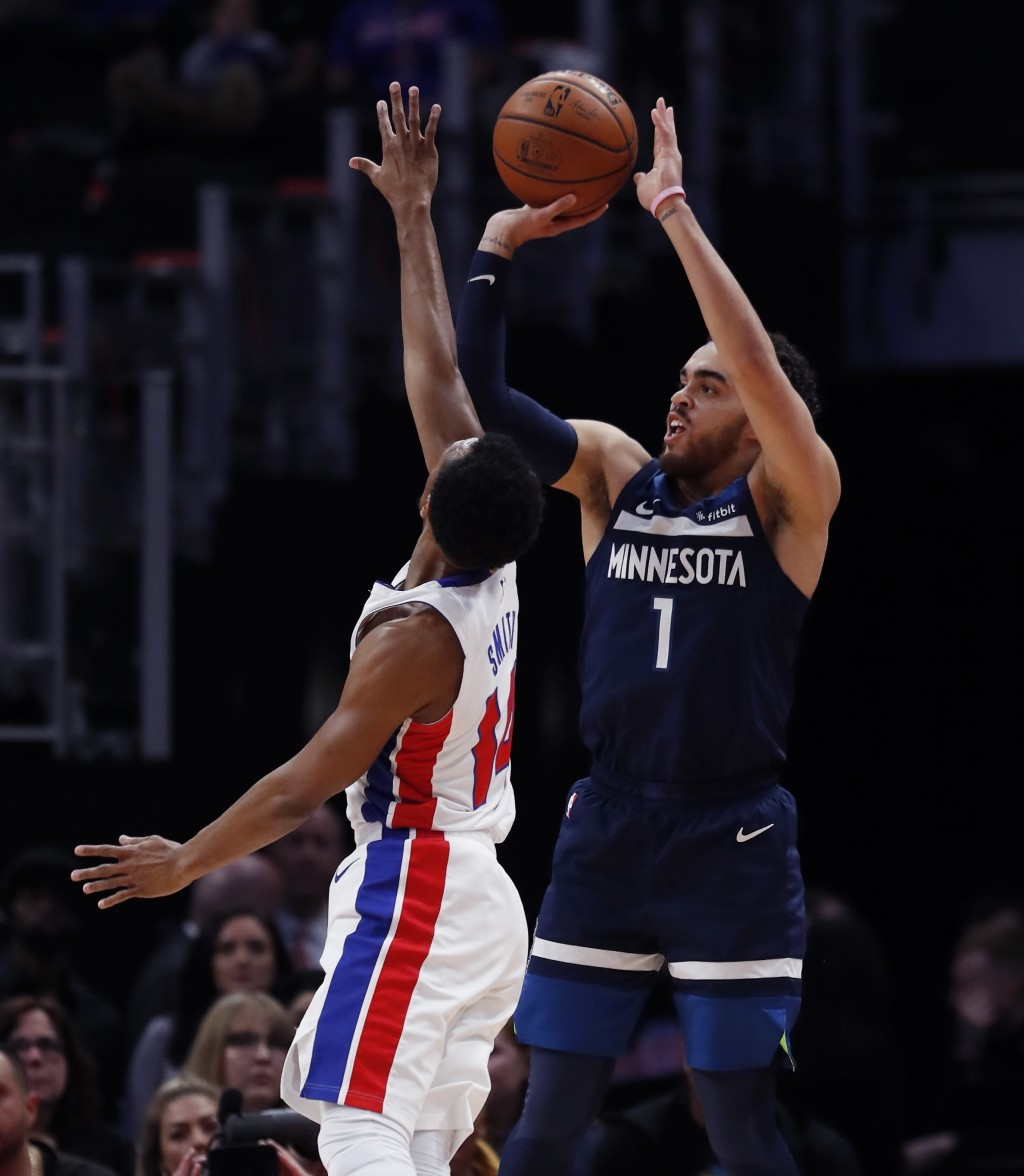Minnesota Timberwolves guard Tyus Jones (1) shoots as Detroit Pistons guard Ish Smith (14) defends during the first half of an NBA basketball game, We