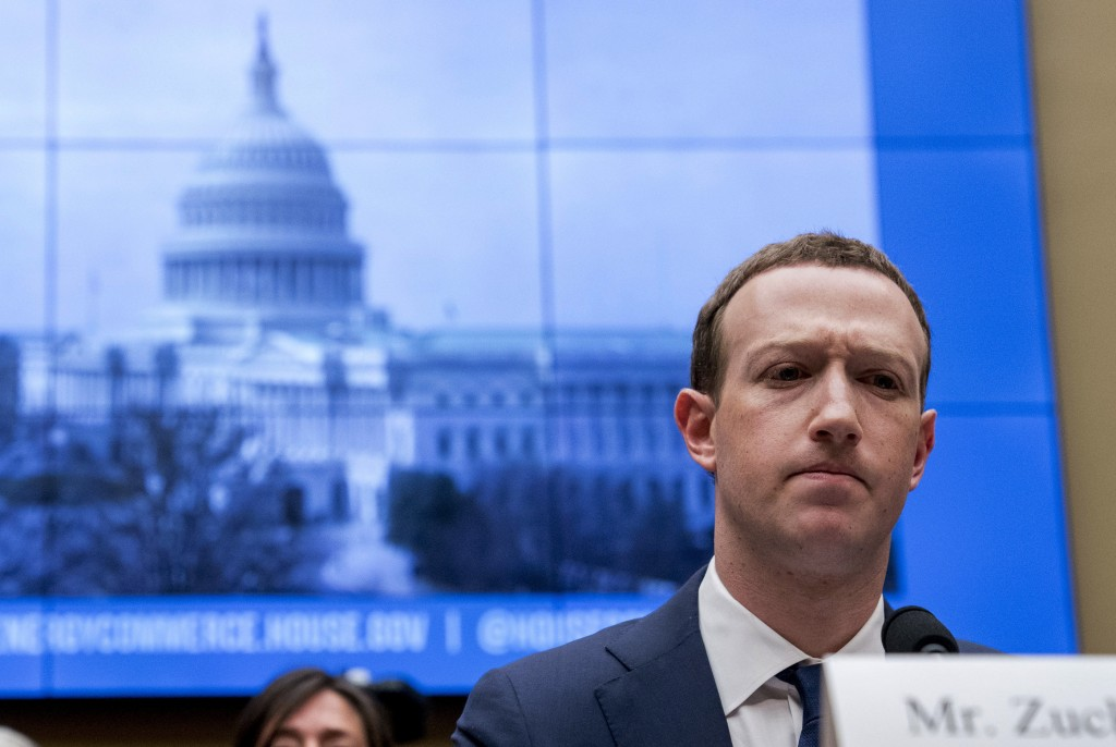 FILE - In this April 11, 2018, file photo, Facebook CEO Mark Zuckerberg pauses while testifying before a House Energy and Commerce hearing on Capitol