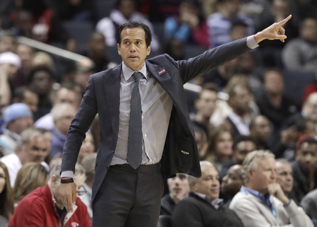 Miami Heat coach Erik Spoelstra gestures during the first half of the team's NBA basketball game against the Charlotte Hornets in Charlotte, N.C., Wed
