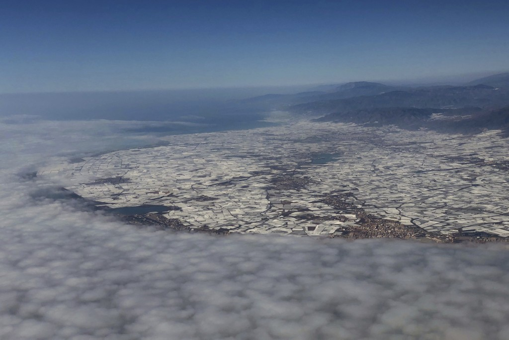 "In this Sunday, March 3, 2019 photo, a general view of greenhouses known as ""Sea of Plastic"" is seen in El Ejido, a municipality of Almería province, ..."