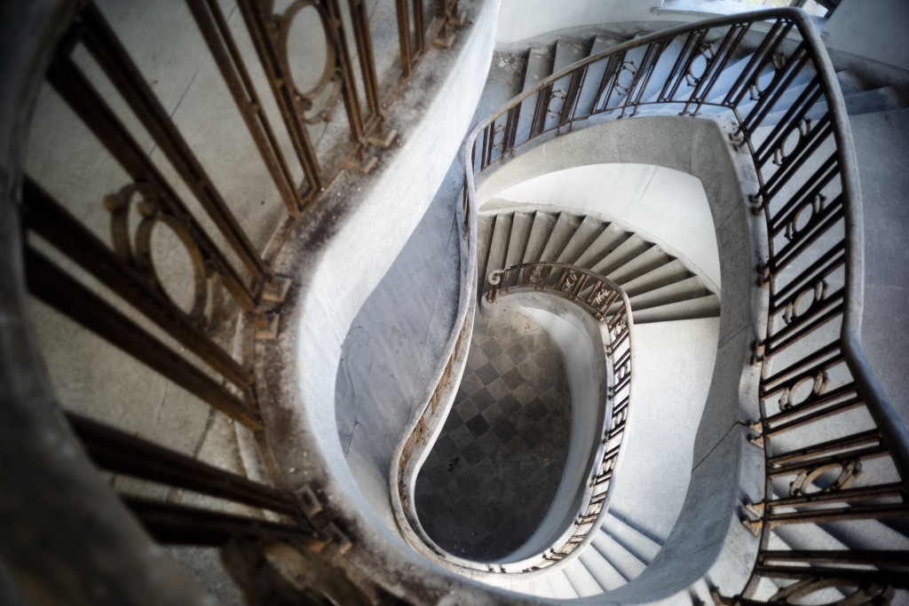 """This Tuesday, Feb. 22, 2019 photo shows the stair case inside the abandoned """"Haus der Offiziere"""", the headquarters for the Soviets' military high comm..."""