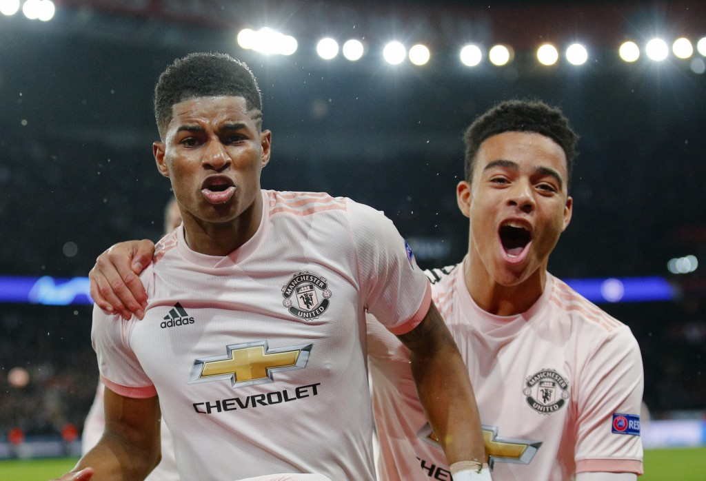 ManU's Marcus Rashford, left, celebrates after scoring his side's third goal during the Champions League round of 16, second leg soccer match between