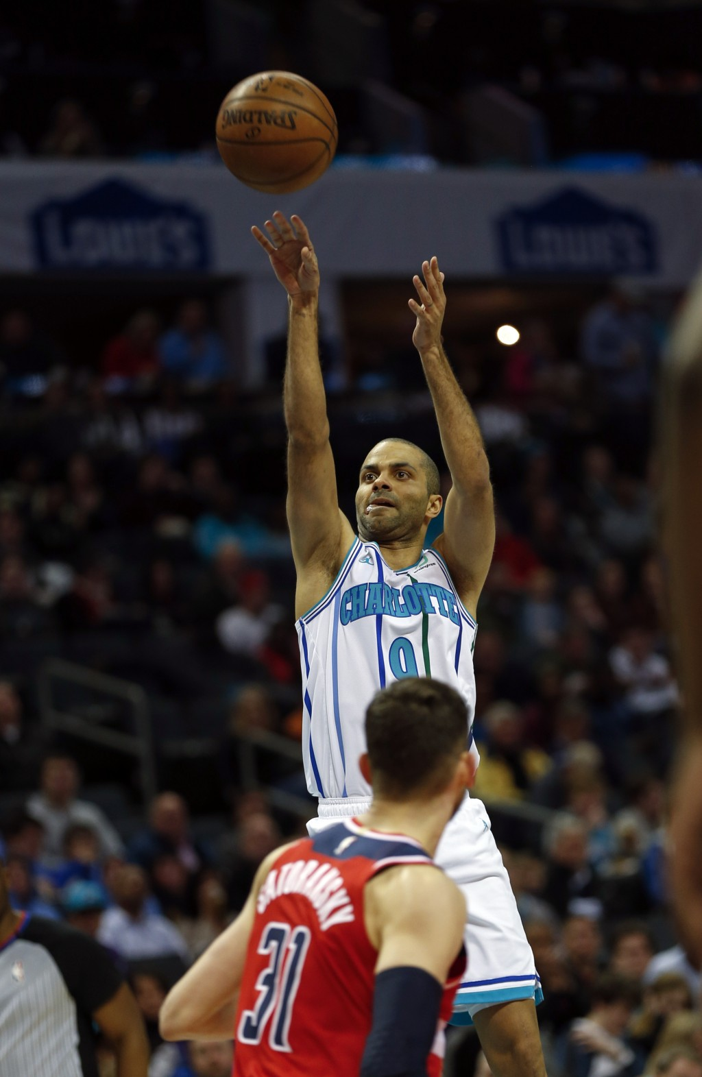 Charlotte Hornets guard Tony Parker (9) shoots over Washington Wizards guard Tomas Satoransky (31) in the first half of an NBA basketball game in Char