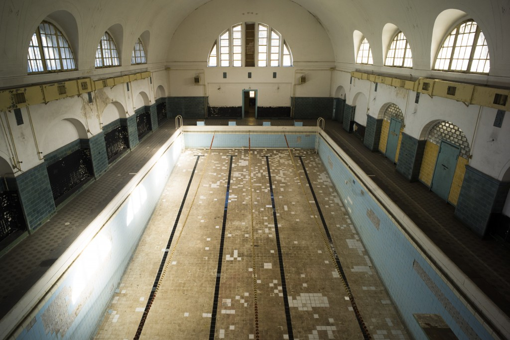 """This Tuesday, Feb. 22, 2019 photo shows the swimming pool in the abandoned compound of the """"Haus der Offiziere"""" the headquarters for the Soviets' mili..."""