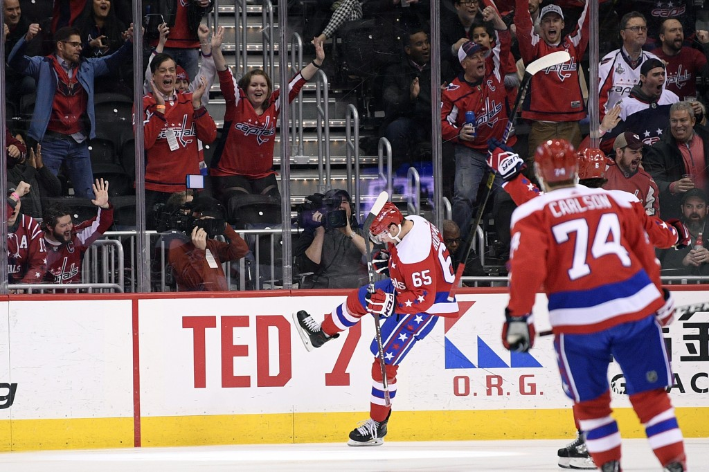 Washington Capitals left wing Andre Burakovsky (65) celebrates his goal during the first period of the team's NHL hockey game against the New Jersey D
