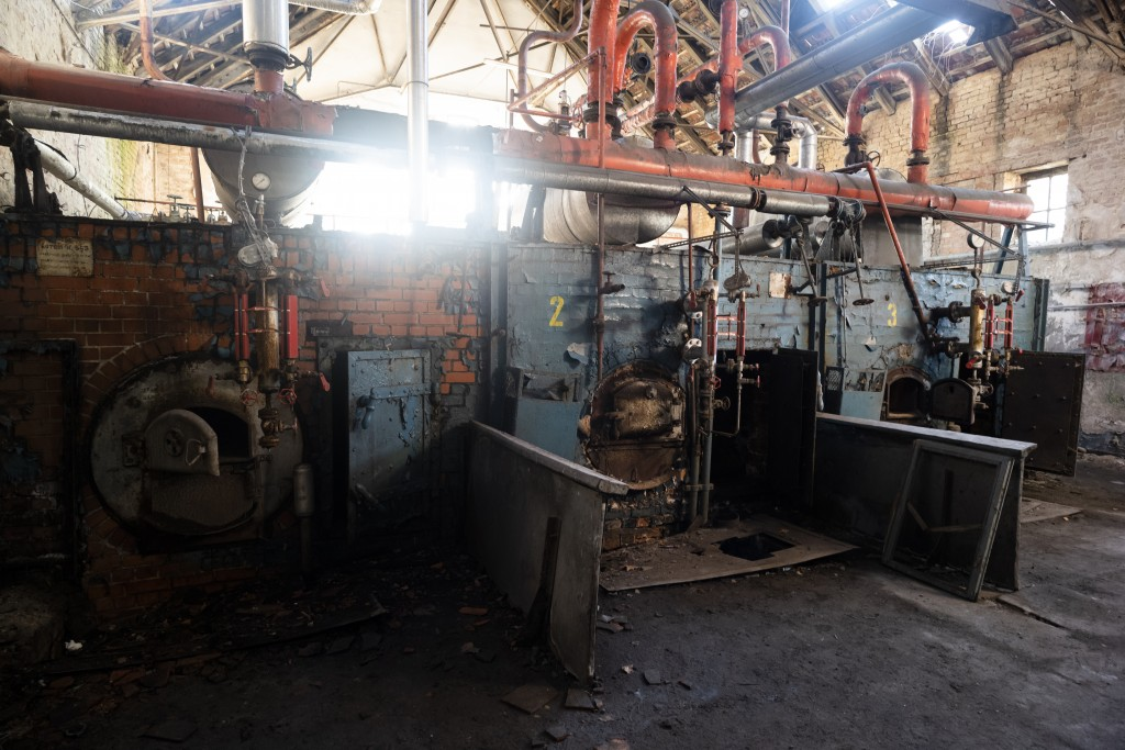 """This Tuesday, Feb. 22, 2019 photo shows the broken power and heat supply station of a swimming pool in the abandoned compound of the """"Haus der Offizie..."""