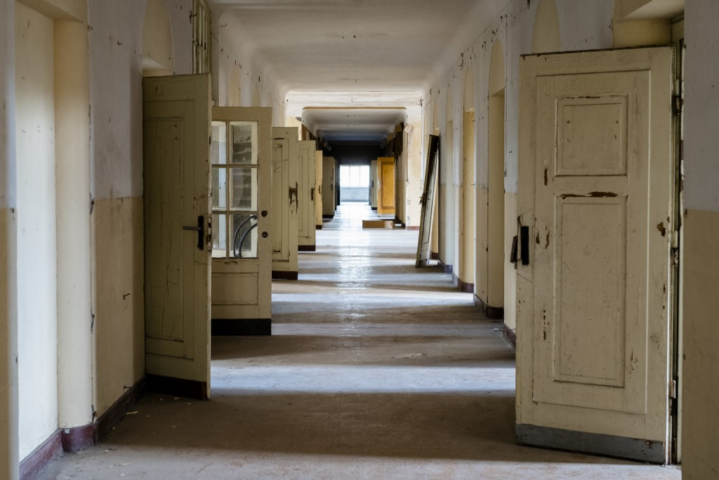 """In this Tuesday, Feb. 22, 2019 photo, the doors stand open in a corridor of the abandoned """"Haus der Offiziere"""", the headquarters for the Soviets' mili..."""