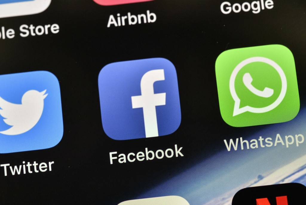 FILE - In this Nov. 15, 2018, file photo the icons of Facebook and WhatsApp are pictured on an iPhone in Gelsenkirchen, Germany. Mark Zuckerberg's pri...