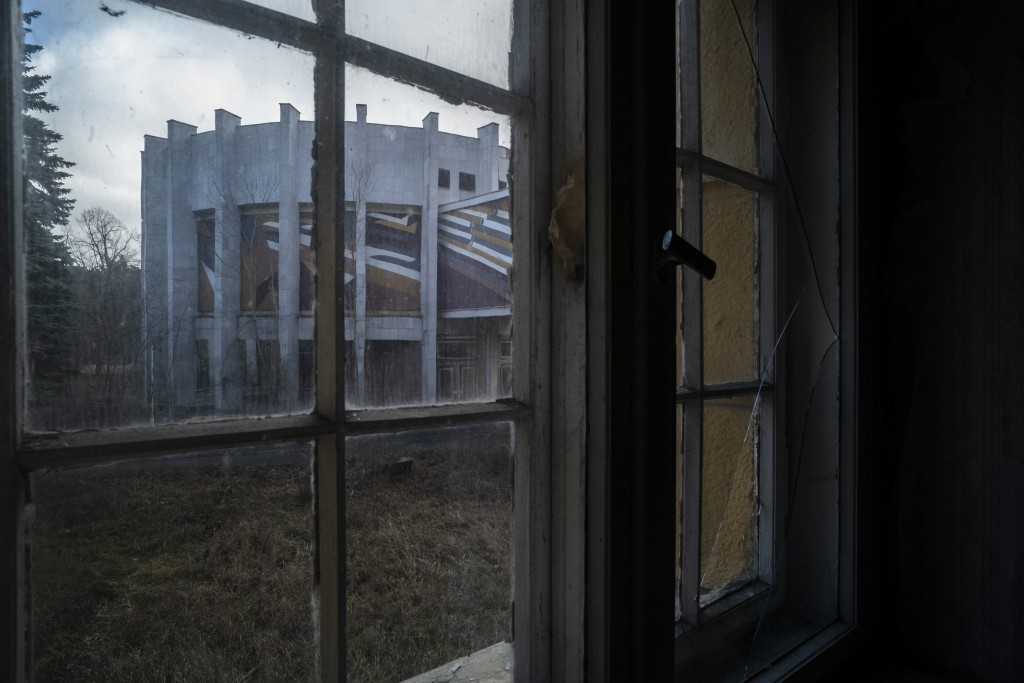 """This Feb. 22, 2019 photo shows view out of a window in the abandoned """"Haus der Offiziere"""", the headquarters for the Soviets' military high command in ..."""