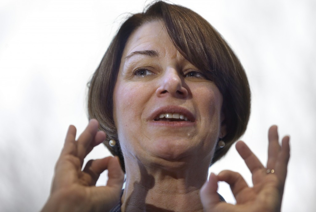 FILE - In this Feb. 24, 2019 file photo U.S. Sen. Amy Klobuchar, D-Minn., speaks to voters during a campaign stop at a home, in Nashua, N.H. Klobuchar