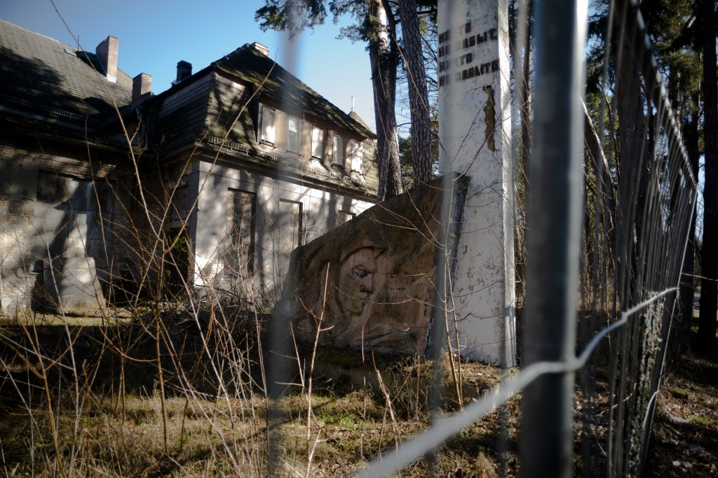 In this Tuesday, Feb. 22, 2019 photo, a monument of the Soviets' stands in front of a abandoned house at the compound of the headquarters for the Sovi...