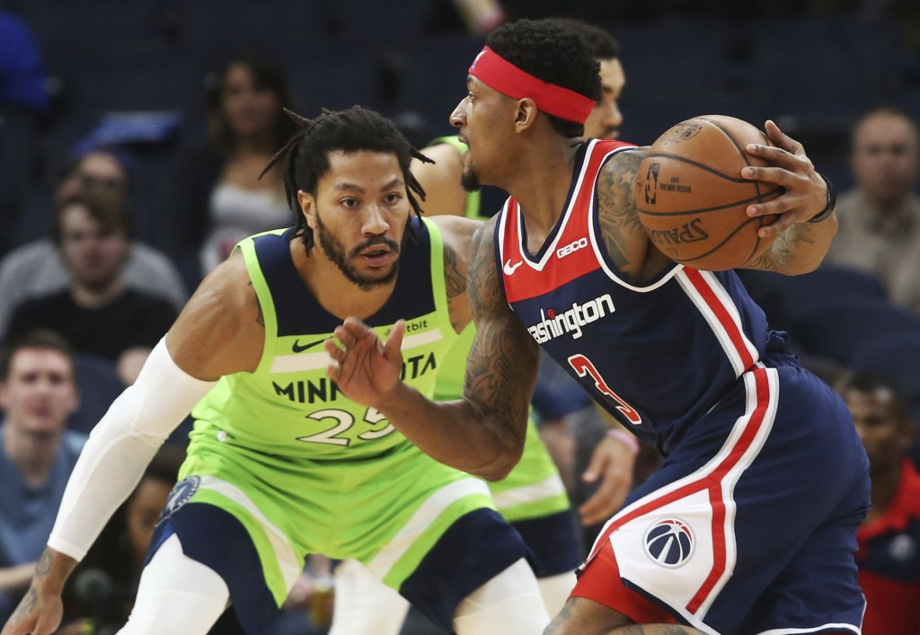 Washington Wizards' Bradley Beal, right, drives against Minnesota Timberwolves' Derrick Rose in the first half of an NBA basketball game Saturday, Mar...
