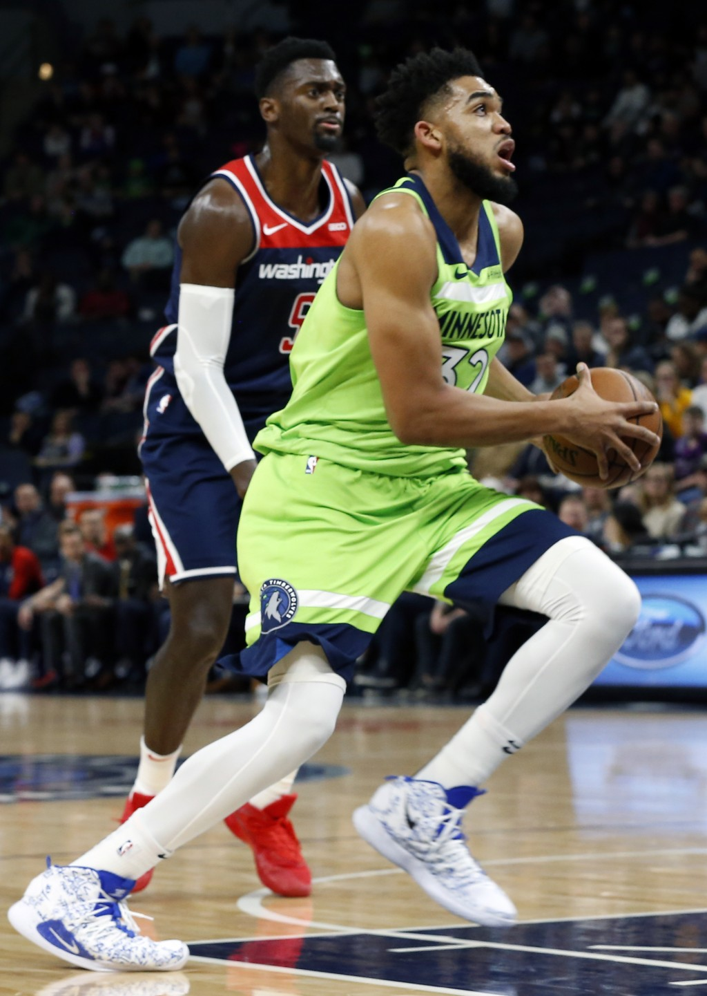 Minnesota Timberwolves' Karl-Anthony Towns, right, drives past Washington Wizards' Bobby Portis in the first half of an NBA basketball game Saturday, ...