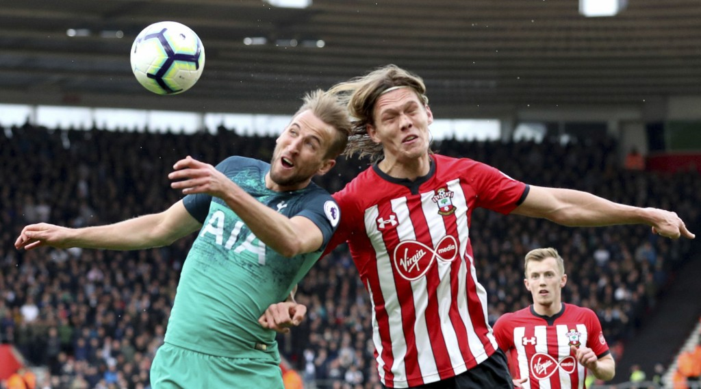 Tottenham Hotspur's Harry Kane, left, and Southampton's Jannik Vestergaard battle for the ball during the English Premier League soccer match at St Ma