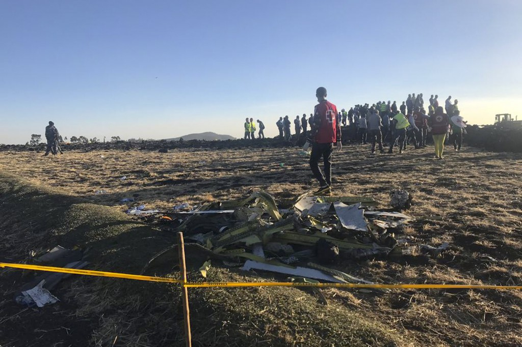 Rescuers search at the scene of an Ethiopian Airlines flight that crashed shortly after takeoff at the scene at Hejere near Bishoftu, or Debre Zeit, s...
