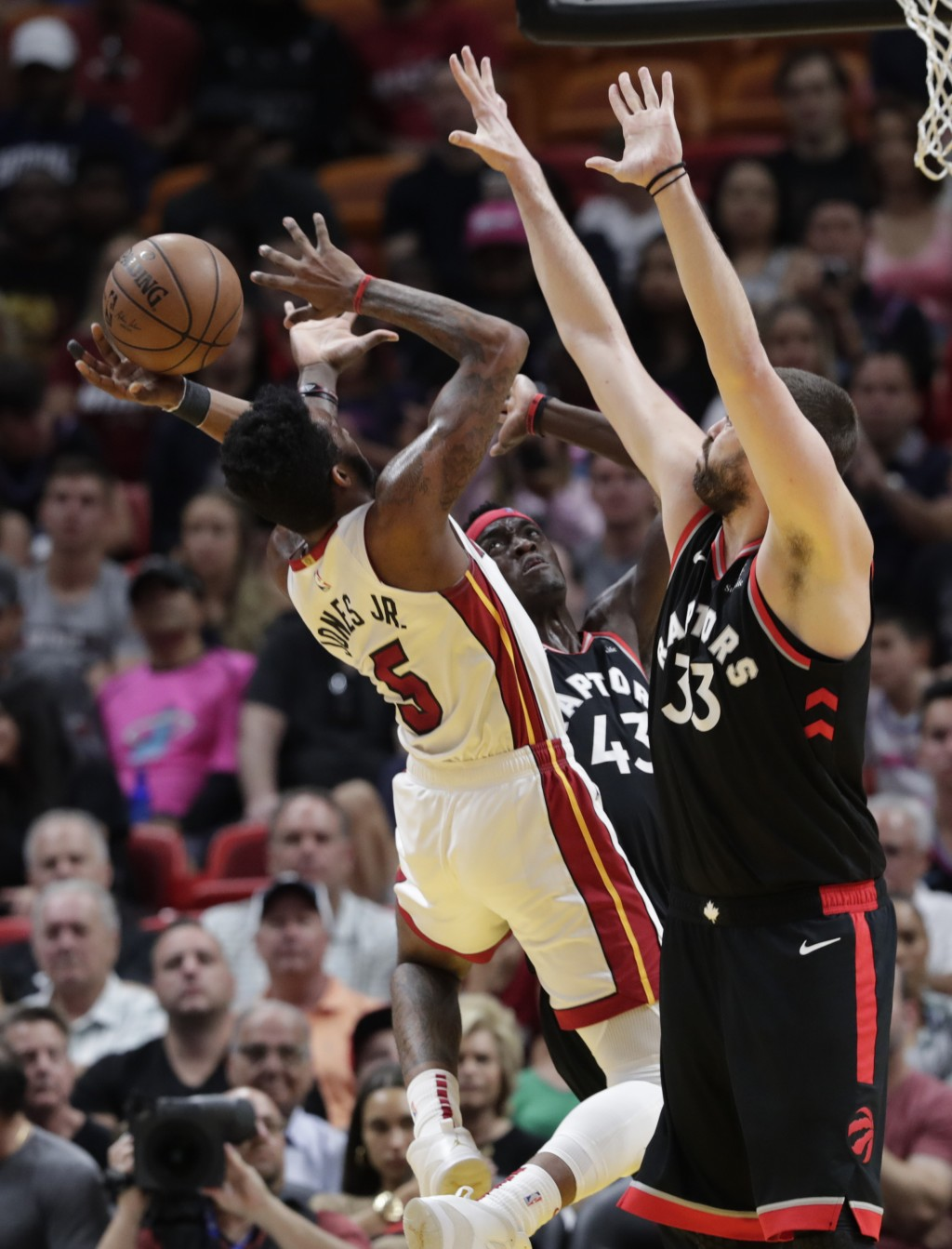 Miami Heat forward Derrick Jones Jr. (5) attempts a shot as Toronto Raptors forward Pascal Siakam (43) and center Marc Gasol (33) defend during the fi