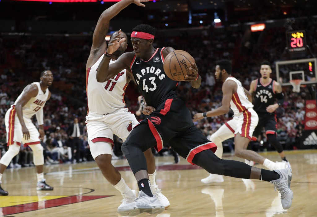 Toronto Raptors forward Pascal Siakam (43) drives to the basket as Miami Heat guard Dion Waiters (11) defends during the first half of an NBA basketba