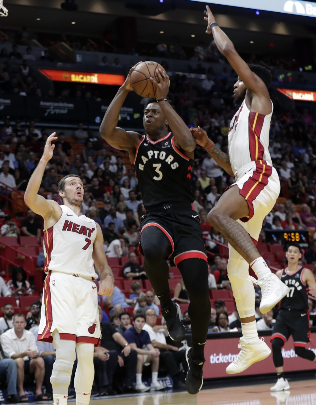 Toronto Raptors forward OG Anunoby (3) droves to the basket as Miami Heat forward Derrick Jones Jr., right, defends during the first half of an NBA ba