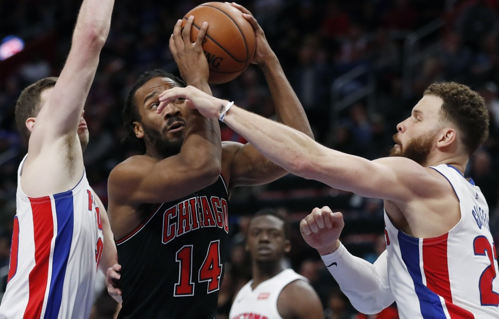Chicago Bulls guard Wayne Selden (14) looks to shoot as Detroit Pistons forwards Jon Leuer, left, and Blake Griffin (23) defend during the first half