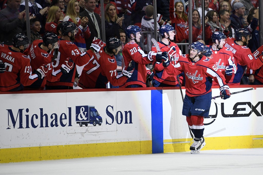 Washington Capitals left wing Carl Hagelin (62), of Sweden, celebrates his goal with the bench during the second period of an NHL hockey game against