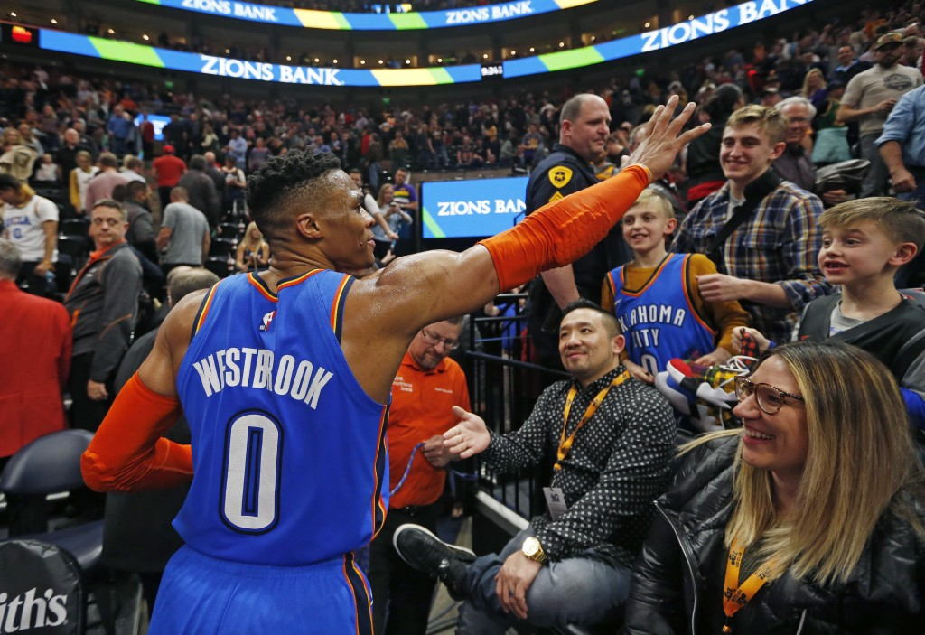 CORRECTS DATELINE TO SALT LAKE CITY INSTEAD OF KEARNS, UTAH - Oklahoma City Thunder guard Russell Westbrook (0) waves to the crowd as he leaves the co
