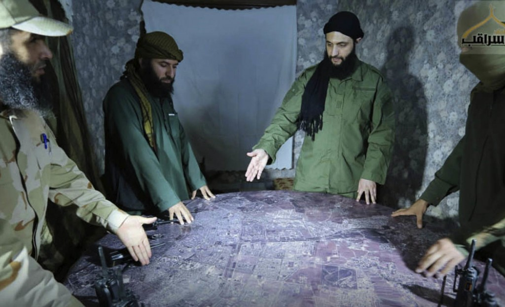 FILE - This undated file photo released by a militant group in 2016, shows Abu Mohammed al-Golani of the militant Levant Liberation Committee and the ...